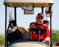 john warren in golf cart